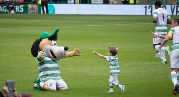 Celtic FC mascot Hoopy hugging a child at Celtic Park