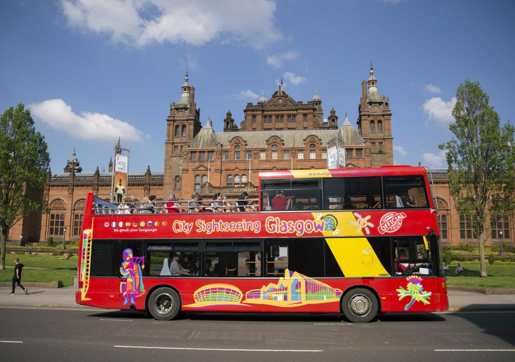 Red tour bus in front of Kelvingrove Museum in Glasgow