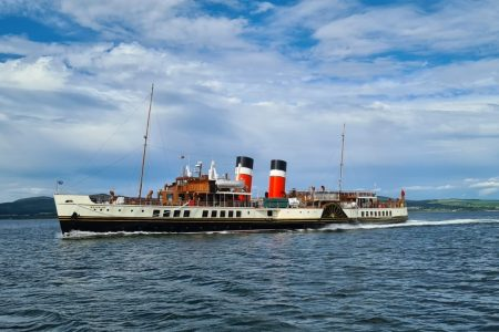 Paddle steamer sailing in good weather.